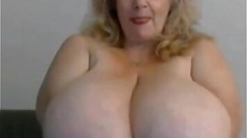 Chubby granny rubbing up on a cute girl with nice round boobies