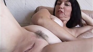 brunet with a lovely pussy is on the bed, kissing