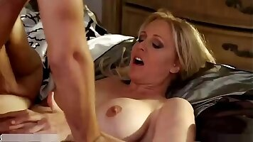 Bridgette B is fucked in the kitchen by the sink