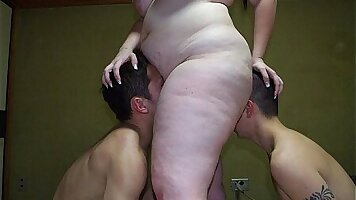 Chubby Japanese chick Natsuko Ozaki is fucking with two studs